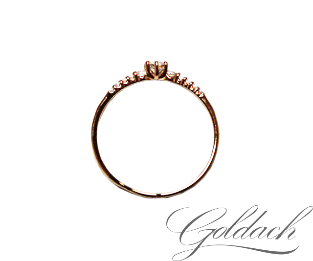 Золотое кольцо с дорожкой из фианитов и крупным фианитом 3.5 мм в центре