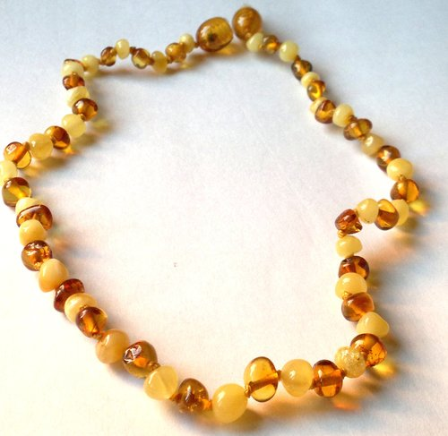 Treated milky and honey amber baby teething necklace